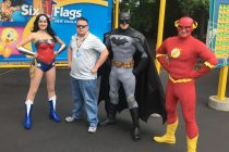 George Morse with superheroes at Six Flags New England.