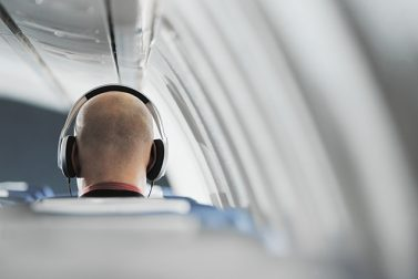 The Best Podcasts to Download for a Long Flight